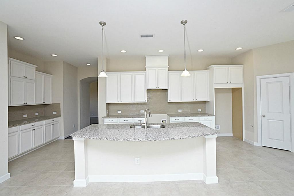 Kitchen by David Weekly Homes at Miramesa